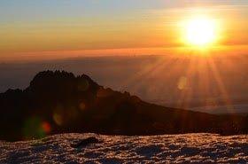 Sunrise from Stella point! Mowenzie peak in the background